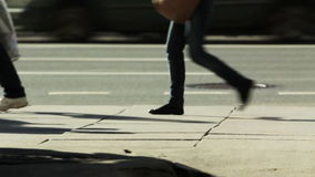 TIME-LAPSE of Pedestrians. HD 1080p: TIME-LAPSE of Pedestrians on a sidewalk - leg level shootingn stock video footage