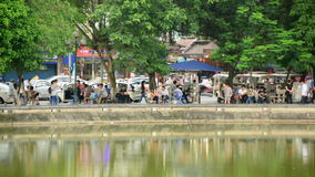 Time Lapse of People on the Banks of Hoan Kiem Lake - Hanoi Vietnam. Hoan Kiem Lake - Hanoi Vietnam stock video