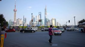 Time lapse,people crossing the road with Shanghai lujiazui business building. stock video footage