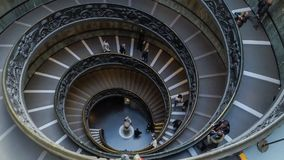 Time lapse of people descend the modern double helix staircase in the Vatican stock video footage