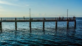 Time lapse of people fishing at bridge stock video