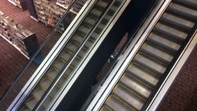 Time lapse of people on moving escalator staircase stock video footage