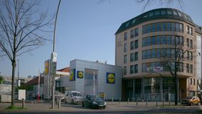 Time Lapse: People And Traffic At Lidl Discount Supermarket In Berlin, Germany stock footage