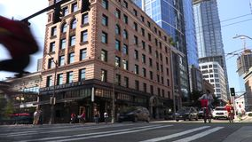 Time lapse of people, cyclists, cars and traffic crossing the junction of Pike Street and Second Avenue, Seattle stock footage