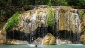 Time-lapse of People traveling and bath in Erawan waterfall, Thailand stock footage