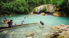 Time-lapse of People traveling and bath in Erawan waterfall, Thailand stock video footage