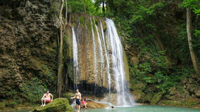 Time-lapse of People traveling and bath in Erawan waterfall, Thailand stock video
