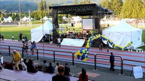Time lapse of people walking on stadium race track with relay for life sepcial event. In Coquitlam center park