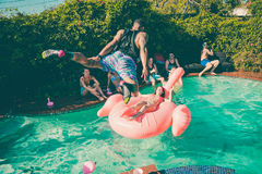 Time Lapse Photo of Man in Black Tank Top Jumping on Clear Swimming Pool Royalty Free Stock Images