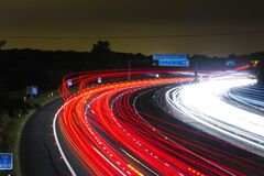 Time Lapse Photography of Car Passing by the Winding Road during Nighttime Royalty Free Stock Photos