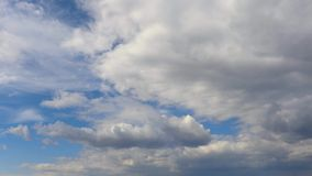 Time-lapse photography - clouds fast flying across the sky stock video