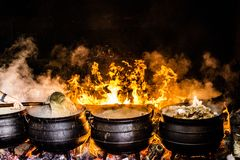 Time Lapse Photography of Four Black Metal Cooking Wares Royalty Free Stock Photo