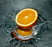 Time Lapse Photography of Orange Fruit on Water Stock Photos