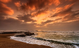 Time Lapse Photography of Sea Waves Under Orange and Gray Sky Royalty Free Stock Photos