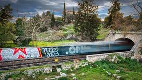 Time Lapse Photography of Train Passing Through Bridge Stock Image