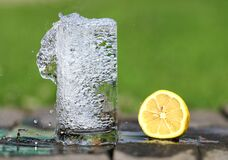 Time Lapse Photography of Water Bobbling Beside Lemon Fruit Stock Image