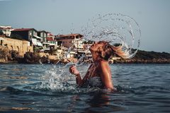 Time-lapse Photography of Woman Playing on Water With Her Hair Stock Photo