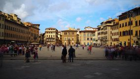 Time lapse of Piazza di Santa Croce, Florence. Florence, October 2017: Time lapse of tourists admire the facade of the Basilica of Santa Croce from the square in stock video footage