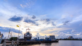 Time lapse, Pier and Port near Chao Praya river and water traffic transportation from Day to Night. Bangkok Thailand stock video footage