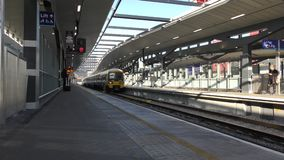 Time lapse. The platform of the station. Arrival of the train. stock video footage