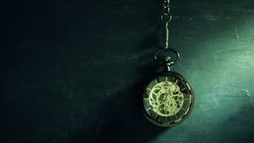 Time lapse pocket watch hanging on black chalkboard and sunlight in morning. Concept of time and education stock video footage