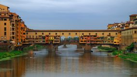 Time lapse of Ponte Vecchio, Florence. Florence, October 2017: Time lapse of old bridge and river Arno on a sunny and cloudless day,on October 2017 in Florence stock video