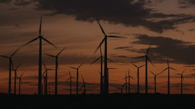Time Lapse of Power Windmills in the California Desert at Sunset. Windmills in Palm Springs California stock footage