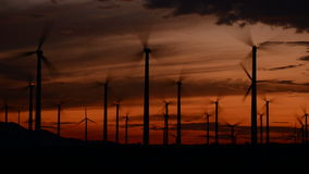 Time Lapse of Power Windmills in the California Desert at Sunset. Windmills in Palm Springs California stock video footage