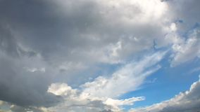 Time-lapse of the rain cloud moving and transforming with the wind. With blue sky, Wide angle stock footage