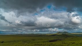 Clouds move over the mountains and plain in Iceland stock video