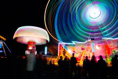 Time Lapse of Ride on Amusement Park during Nightime Royalty Free Stock Photos
