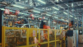 Time Lapse Robotics work in production line of car