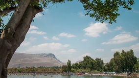Time lapse of running clouds over the mountains of Galilee and Galilee sae, Israe l Royalty Free Stock Photo