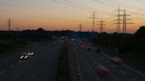 Time lapse of rush hour traffic. On German highway A66, high-angle view at dawn stock footage