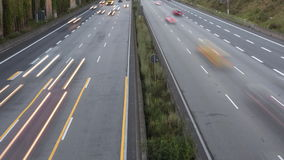 Time lapse of rush hour traffic. On German highway A66, high-angle view at dawn stock video footage