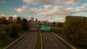 Time Lapse of Rush Hour Traffic on Interstate 5 Highway with Portland Oregon City Skyline and Clouds in Autumn Season 1080p stock video