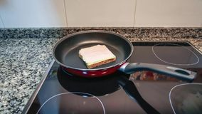 Time lapse of sandwich mount and cook process stock video footage