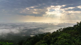 Time-lapse scene of cloudy sky with ray of sun light over city. Chiang Mai, Thailand stock video