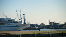 Time-lapse of a seaport. A time-lapse video of seaport activity. A passenger ship sails by while cranes work loading and unloading cargo stock video