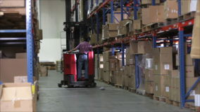 Time Lapse Sequence Fork Lift In Warehouse
