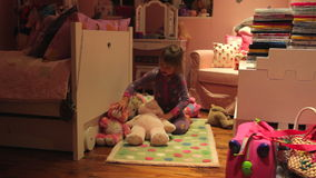Time-Lapse Sequence Of Girl Arranging Toys In Bedroom stock footage