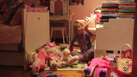 Time-Lapse Sequence Of Girl Moving Toys To Make Bed On Floor stock video footage