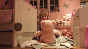 Time-Lapse Sequence Of Girl Playing With Toys In Bedroom stock video