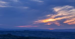 Sunset clouds over hills of Shropshire UK. Time lapse sequence of scenic hills at hazy summer sunset in Shropshire, United Kingdom stock footage