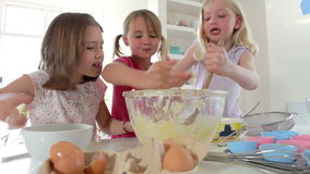 Time Lapse Sequence Of Three Girls Making Cake Together Stock Image