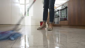 Time Lapse Sequence Of Woman Mopping Kitchen Floor Royalty Free Stock Photos