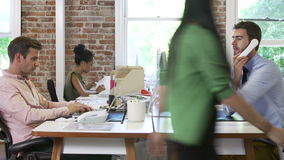 Time Lapse Sequence Of Workers At Desks In Design Office