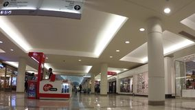 Time lapse of shopper inside Metropolis shopping mall stock video