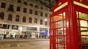 Time-Lapse-shot of British telephone booth and street traffic Hyper lapse. Time lapse shot of British telephone booth and street traffic Hyper lapse stock video footage