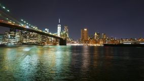 Time-lapse shot of Brooklyn Bridge and Manhattan skyline by night in 4k stock video footage